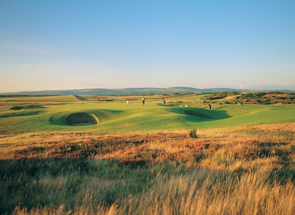 Golfers playing on the Royal Porthcawl golf course