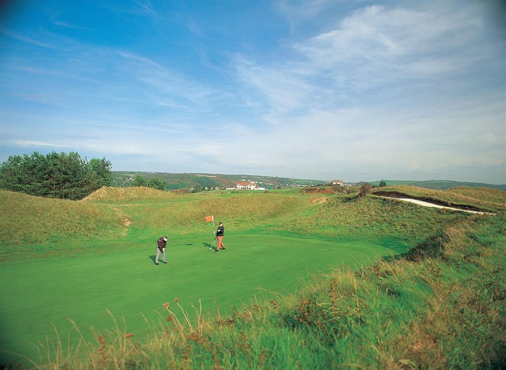 Golfers putting on the Ashburnham golf course