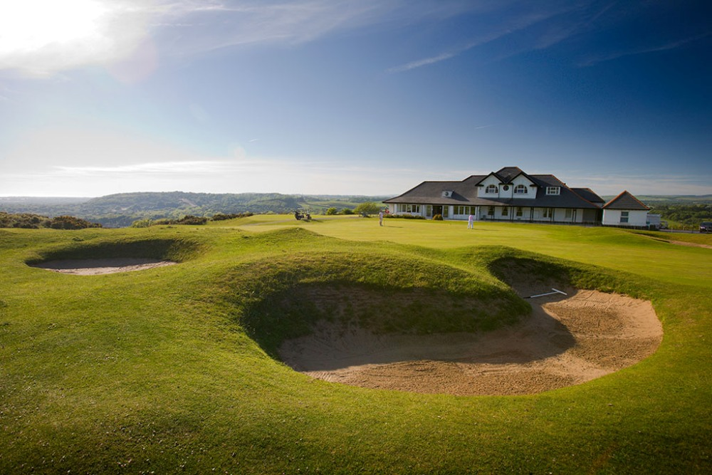 18th green and clubhouse on Southerndown golf course