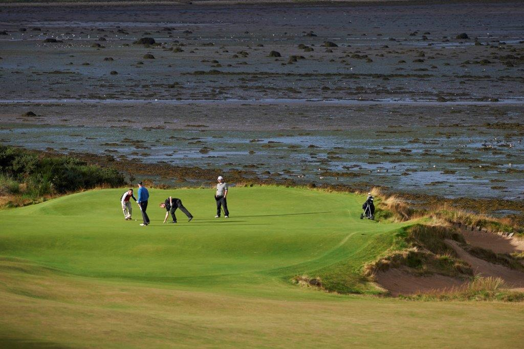 Golfers on the 3rd green at Castle Stuart during the Tomatin Pro Am