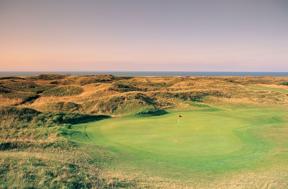 Green and dunes on Pyle and Kenfig golf course