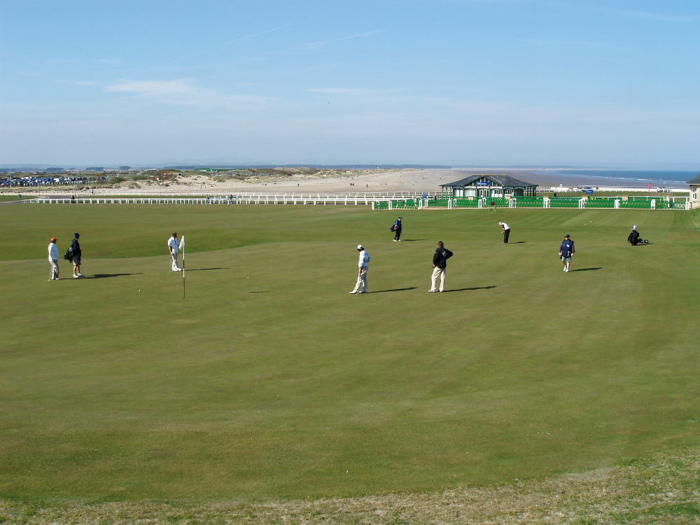 Golfers on the 18th green of the Old Course at St Andrews
