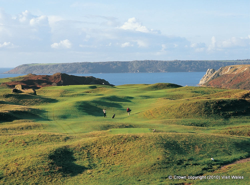 Golfers playing on Pennard golf course