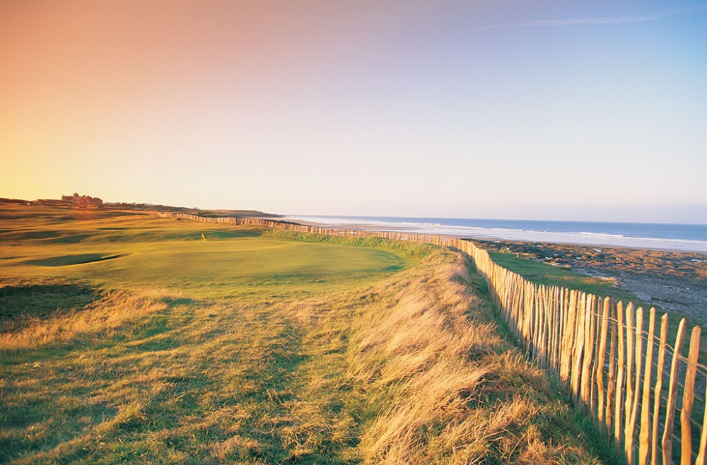 Undulated green and sea on the Royal Porthcawl golf course