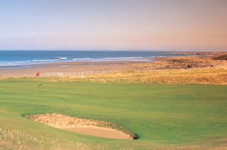Large green and beach on the Royal Porthcawl golf course