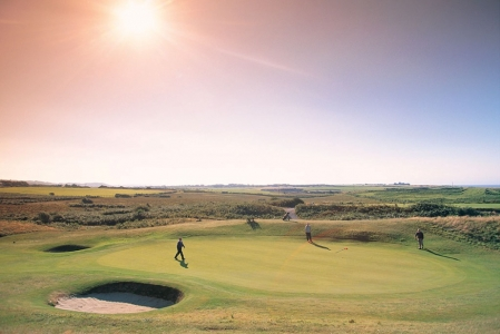 Players putting on Pyle and Kenfig golf course