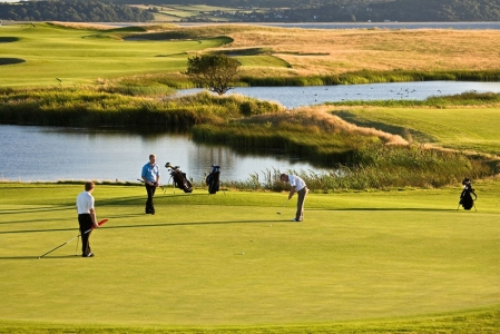 Golfers playing on the Machynys golf course