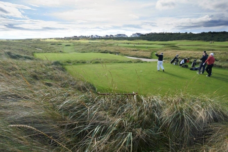 Golfers playing at Royal Dornoch during the Tomatin Pro Am