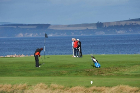 Golfers putting at Nairn during the Tomatin Pro Am