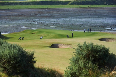 Golfers on the 3rd hole at Castle Stuart