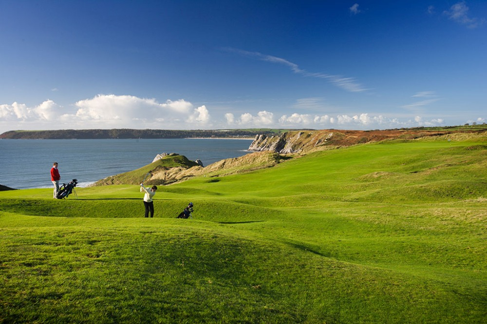 Player swinging on Pennard golf course