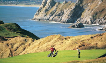 Golfers playing Pennard golf course in Wales