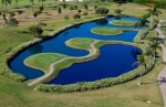 Four tees on a lake at the Damha golf course
