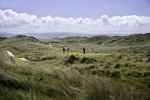 Golfistas jugando sobre el campo de golf de Aberdovey