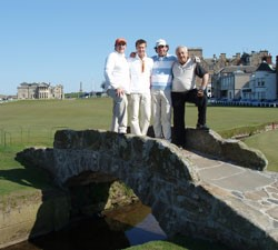 Image of four golfers standing on the iconic bridge on the St Andrews Old Course