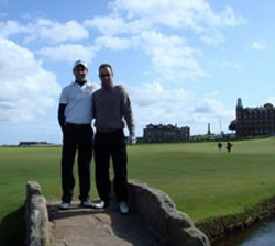 Image of two golfers standing on bridge at St Andrews Old Course