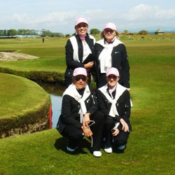 Image of four golfers on a Scottish golf course