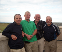 Image of four golfers on Scottish golf course enjoying the sunshine