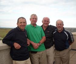 Image of four golfers on Scottish golf course enjoying the sunshine