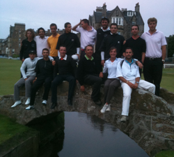 Image of a group of golfers sitting on the bridge at St Andrews Old Course golf course