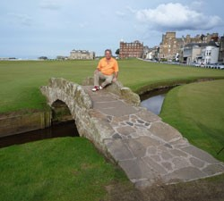 Image of golfer sitting on iconic bridge at St Andrews Old Course