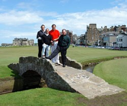 Image of bridge at Old Course in St Andrews with group of golfers standing on bridge