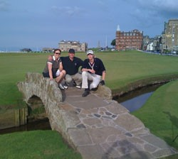 Image of three golfers at St Andrews Old Course