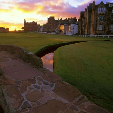 Image of iconic bridge at St Andrews Old Course at sunset